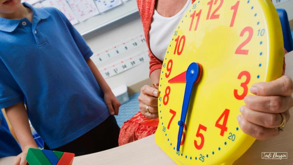 teacher showing student how to tell time