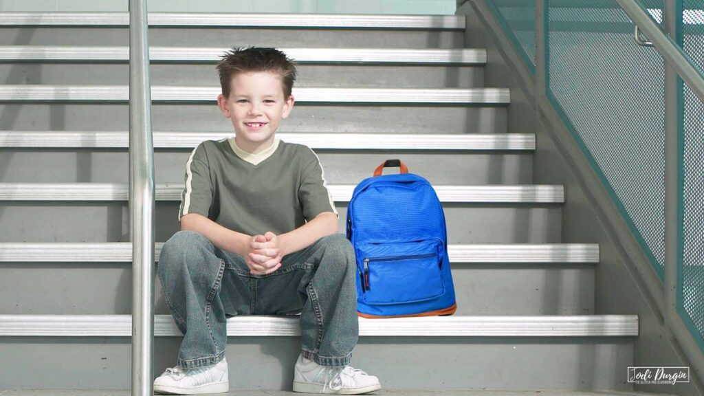 elementary student on stairs
