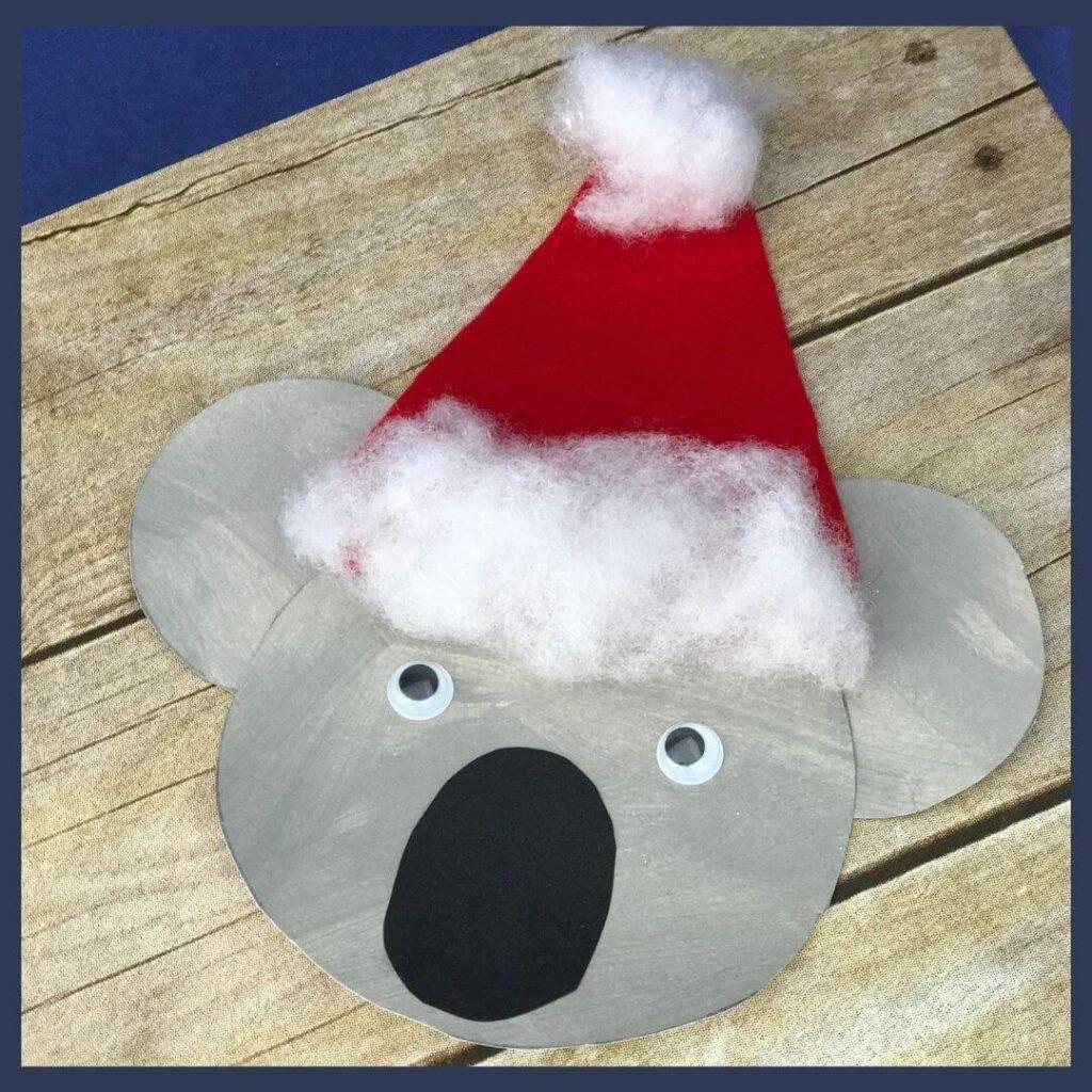 An Australian Christmas craft that is a koala bear with a Santa hat on his head