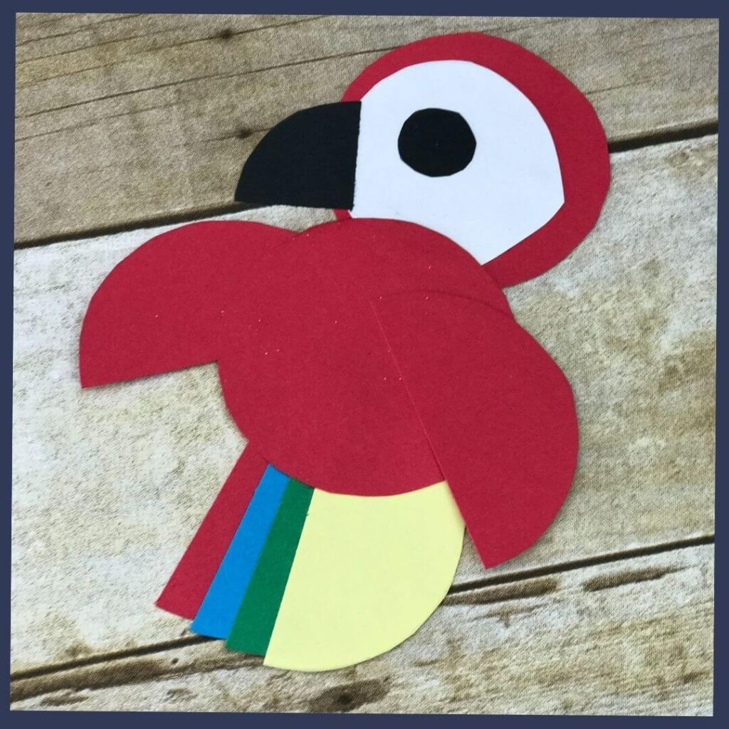 A Brazil Christmas craft that is a red parrot with feathers