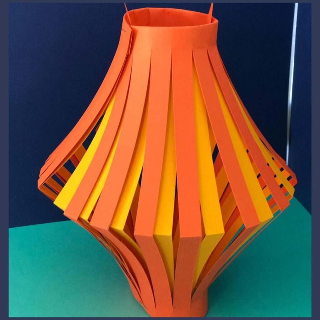 A Chinese New Year craft that is a orange and yellow paper lantern