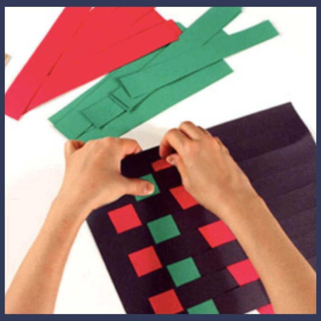 A woven mat Kwanzaa craft made of red, green and black paper