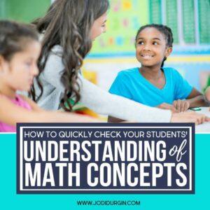 teacher helping a girl with a math problem