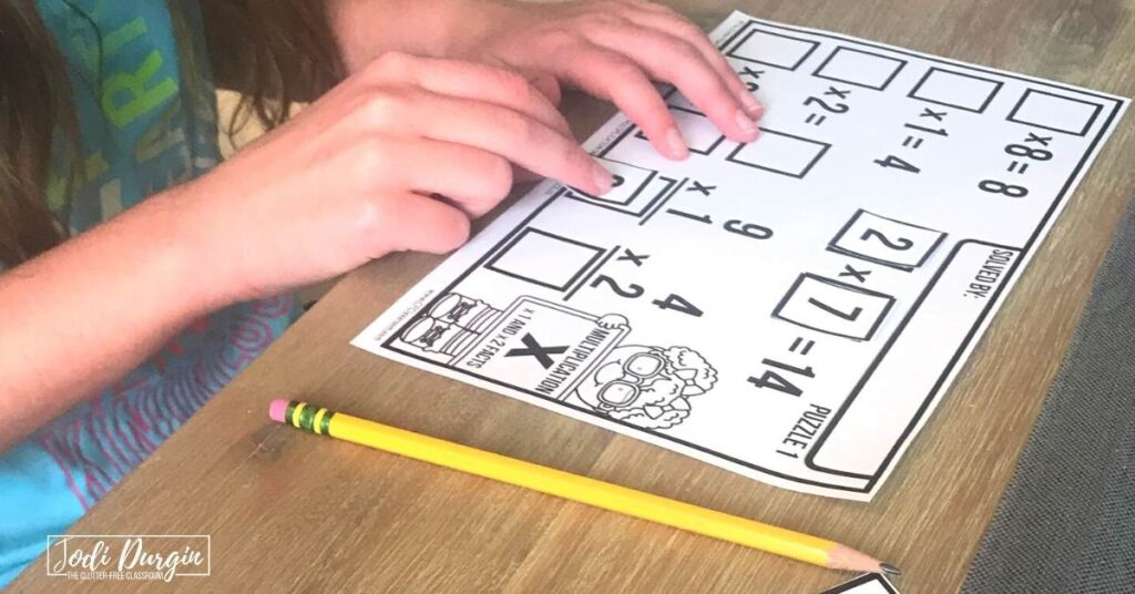 3rd grader working on number tile math puzzle activity