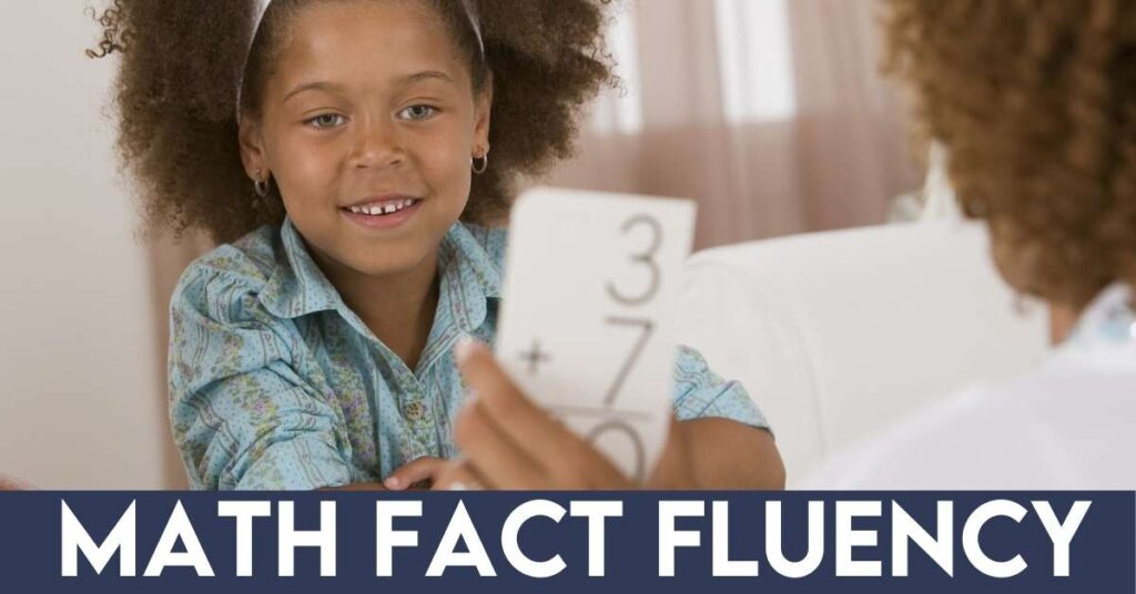 girl practicing math facts with flash cards