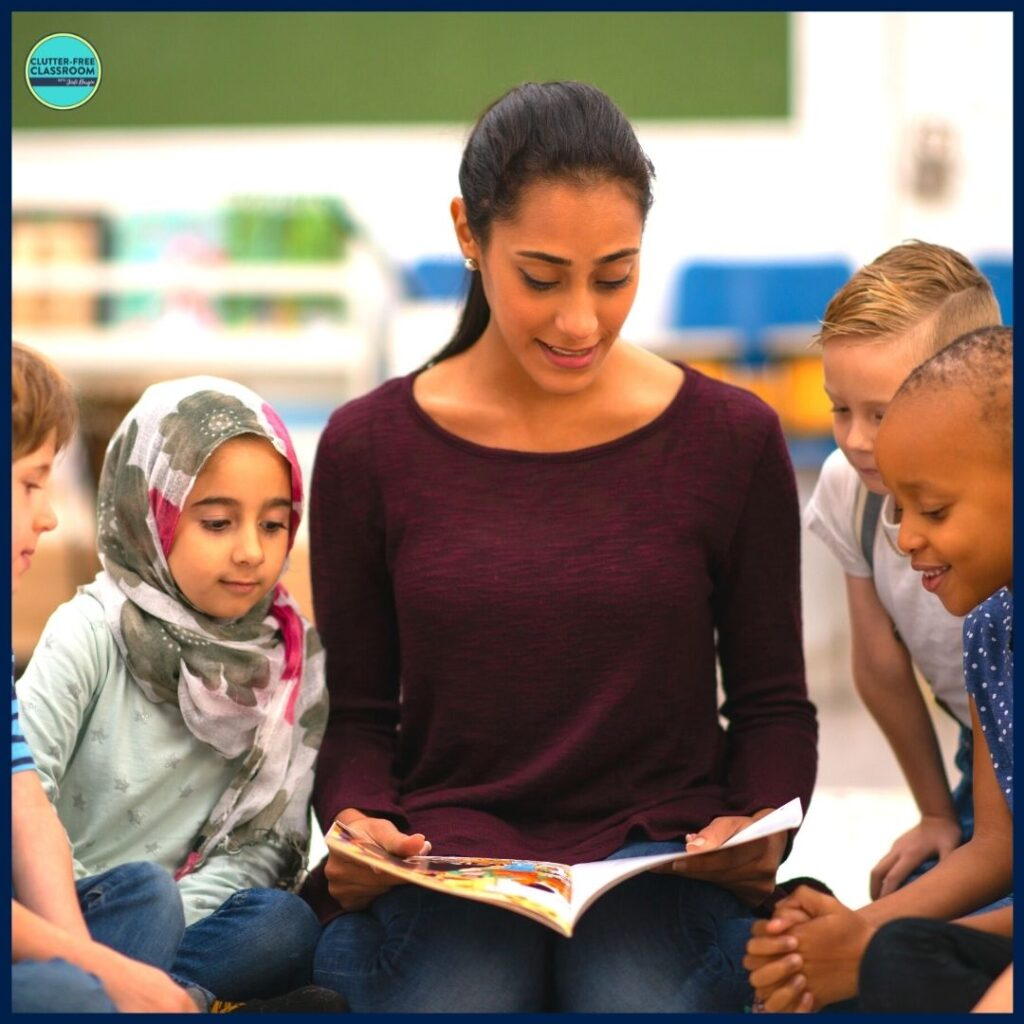 elementary teacher reading aloud a picture book to her students